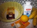 Печенье савоярди - 1 пачка (400 грамм) Бананы - 3 штуки Сливки жирности 35% - 500 мл Ванилин - по вкусу Какао - 2-3 столовые ложки Йогурт - 1/2 стакана Сахар - 1/2 стакана Желатин пищевой – 1,2 ст.ложки Виноград - несколько виноградин